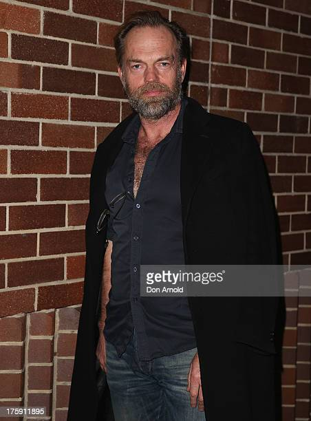 Hugo Weaving arrives at the opening night of Rosencrantz Guildenstern are Dead at the Sydney Theatre Company on August 10 2013 in Sydney Australia