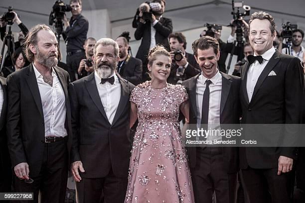 Hugo Weaving director Mel Gibson actor Vince Vaughn actress Teresa Palmer actor Andrew Garfield and actor Luke Bracey attend a premiere for 'Hacksaw...