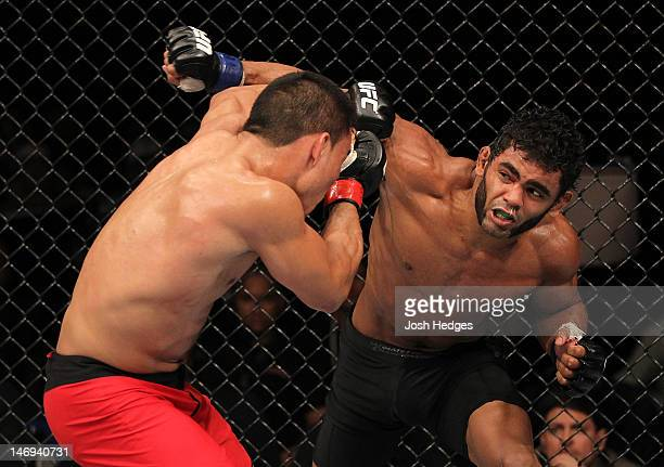 Hugo Wolverine Viana punches John Teixeira during their UFC 147 featherweight bout at Estadio Jornalista Felipe Drummond on June 23 2012 in Belo...