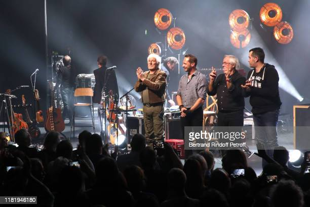 Hugues Aufray and his musicians acknowledge the applause of the audience at the end of his Concert at Salle Pleyel on October 18 2019 in Paris France