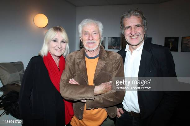 Hugues Aufray standing between Radio Host Julie Leclerc and her husband Gerard Leclerc pose after Hugues Aufray performed at Salle Pleyel on October...