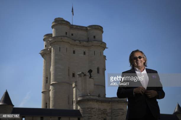Hugues de Sade a descendant of French writer the Marquis de Sade poses in front of the donjon of the Vincennes castle on July 2 2014 in Vincennes...