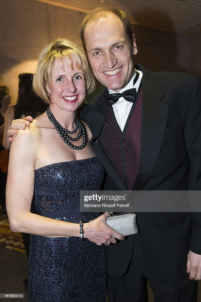 Hugues Quennec, President of the 'Sport for Life' foundation (R), and his wife attend the 30th edition of 'La Nuit Des Neiges' Charity Gala on February 16, 2013 in Crans-Montana, Switzerland.