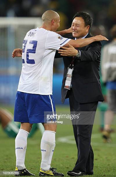 Huh Jung Moo head coach of South Korea celebrates with Cha DuRi after a draw gives them victory and progress to round two in the 2010 FIFA World Cup...