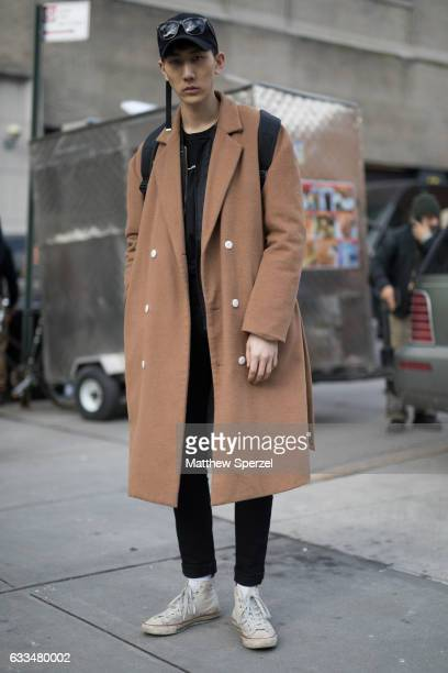 Hui An is seen attending Patrik Ervell/You As/John Elliott wearing his own deisgn tan long coat with black outfit and white sneakers on February 1...