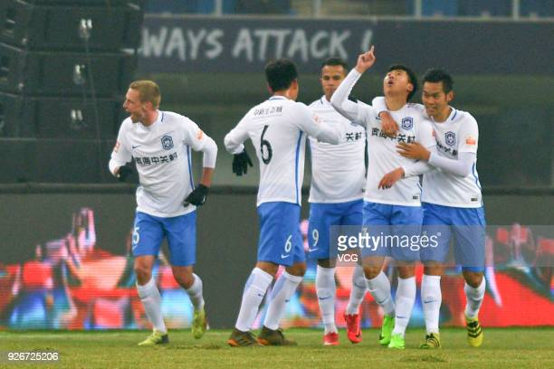 Hui Jiakang of Tianjin Teda celebrates a point with teammates during the 2018 Chinese Football Association Super League first round match between...