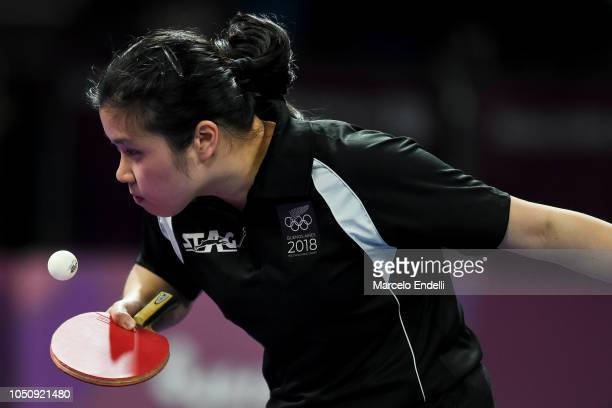 Hui Ling Vong of New Zealand hits a return against Bruna TaKahashi of Brazil during the women's singles preliminary stage match on day 1 of the...