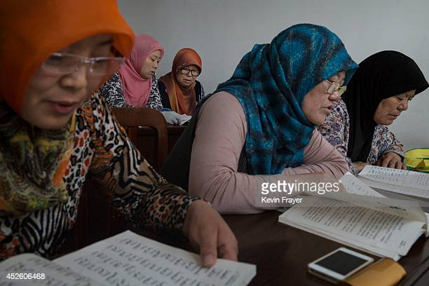 Hui Muslim women study during Arabic lessons at the Qingzhenshang women's only Mosque on July 11 2014 in Sangpo Henan Province China As part of a...