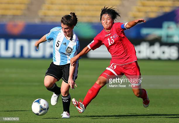 Hui Sun O of Korea DPR and Camila Gomez Ares of Argentina battle for the ball during the FIFA U20 Women's World Cup 2012 group C match between Korea...