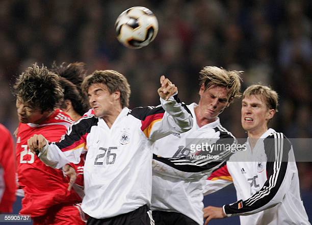 Hui Xie of China ,Sebastian Deisler, Tim Borowski and Per Mertesacker of Germany go up for the ball during the friendly game between Germany and...