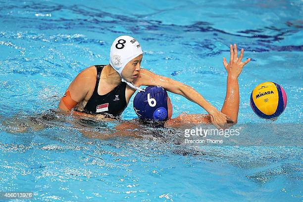 Hui Ying Lynnette Jane Tan of Singapore competes with Ayaka Takahashi of Japan in the Women's Single Round Robin Waterpolo during day five of the...