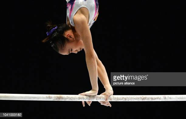 Huidan Huang of China competes at the Asymmetric bars during the women's Apparatus final at the Artistic Gymnastics World Championships in Antwerp...