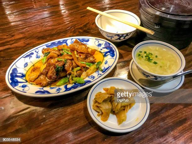 Huiguorou lunch meal served on table, daily personal perspective view