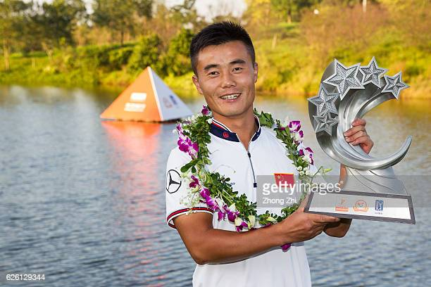 Huiling Zhang of China poses for photo with champion trophy after winning the Buick open at Guangzhou Foison Golf Club on November 27 2016 in...