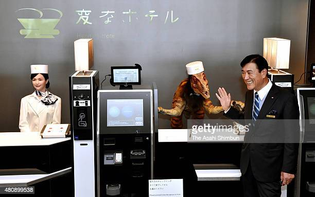 Huis ten Bosch President Hideo Sawada introduces humanoid robots replacing human staffs at the check in counter at the Henn na Hotel in Huis Ten...