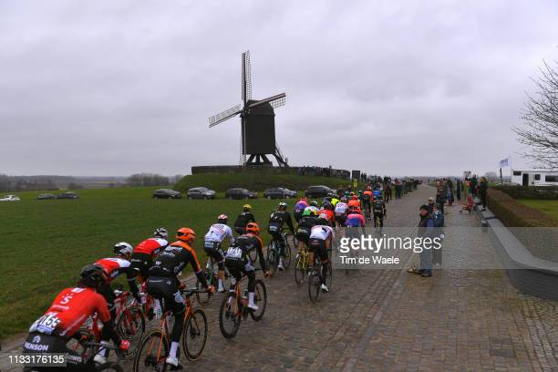 Huisepontweg / Peloton / Landscape / Peloton / Fans / Public / Cobblestones / Windmill / during the 74th Omloop Het Nieuwsblad 2019 a 200km race from...
