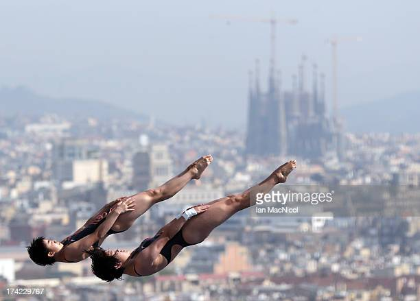 Huixia Liu and Ruolin Chen of China compete in the preliminary round of The Women's 10m Syncro Platform at The Piscina Municipal De Montjuic on day...