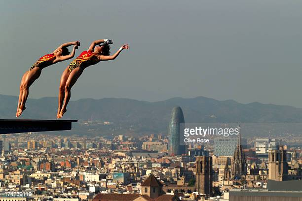 Huixia Liu and Ruolin Chen of China compete in the Women's 10m Springboard Diving final on day three of the 15th FINA World Championships at Piscina...