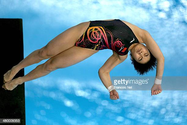 Huixia Liu of China dives in the Women's 10m Platform semi final during day three of the FINA/NVC Diving World Series 2014 at the Hamdan Sports...