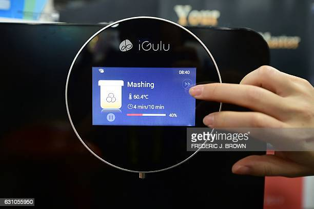 Huiyan Gao gives a demonstration on the iGulu during the 2017 Consumer Electronic Show in Las Vegas Nevada on January 5 2017 The iGulu is an...
