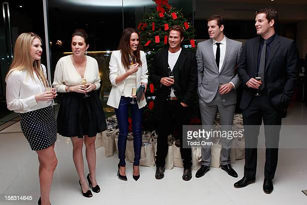 Hukkster CoFounders Erica Bell and Katie Finnegan Louise Roe Cameron Winklevoss and Tyler Winklevoss and Jason Lewis toast at the Hukkster Holiday...