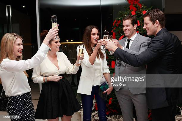 Hukkster CoFounders Erica Bell and Katie Finnegan Louise Roe Cameron Winklevoss and Tyler Winklevoss pose at the Hukkster Holiday Party at a Private...
