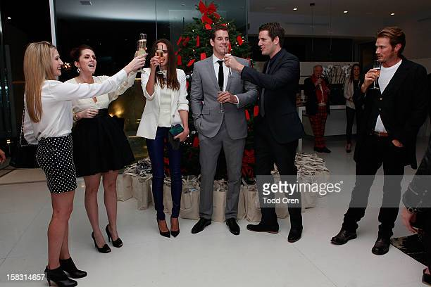 Hukkster CoFounders Erica Bell and Katie Finnegan Louise Roe Cameron Winklevoss and Tyler Winklevoss and Jason Lewis pose at the Hukkster Holiday...