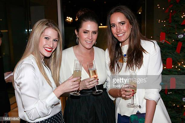 Hukkster CoFounders Erica Bell Katie Finnegan and TV Host Louise Roe pose at the Hukkster Holiday Party Private Residence on December 12 2012 in Los...