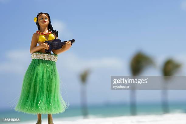 hula dancer, figurine on beach - hula dancer stock pictures, royalty-free photos & images
