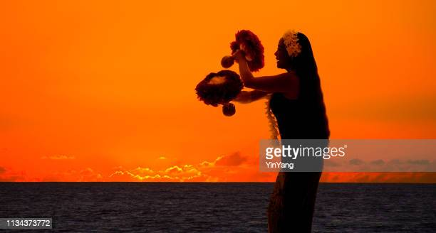 hula dancer on hawaiian beach at sunset with copy space - showgirl stock pictures, royalty-free photos & images