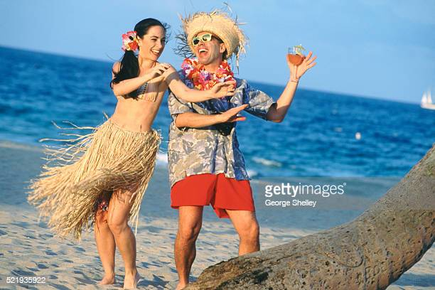 hula dancing on the beach - lei day hawaii stock pictures, royalty-free photos & images