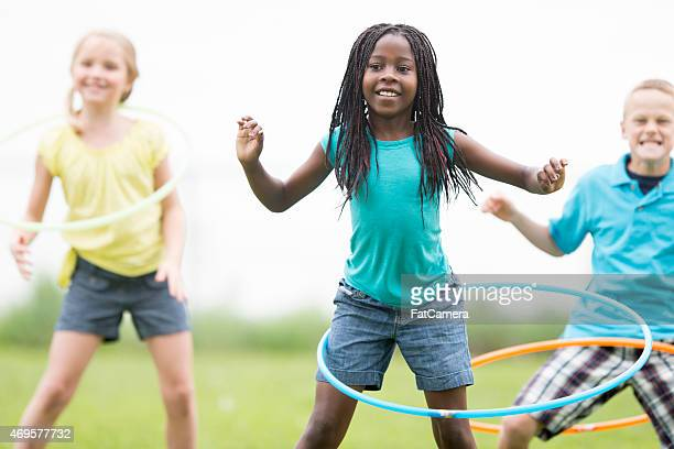 hula hooping at the park - physical education stock pictures, royalty-free photos & images