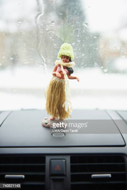 Hula statue on car dashboard