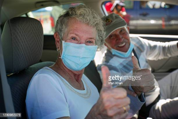 Hulene Dykstra, left, with her husband Heinz Beer, in an upbeat mood after getting her first dose of Moderna mRNA-1273 at a super COVID-19...
