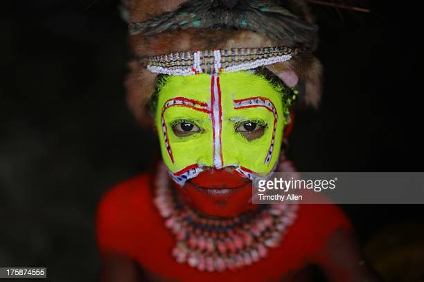 Huli tribal girl with yellow and red face paint