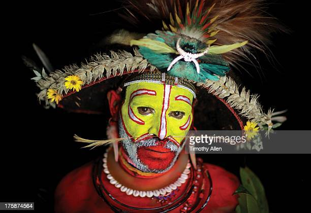 Huli Tribe wigman with face paint and feathers