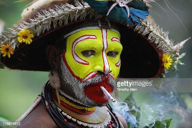 Huli wigman smoking cigarette