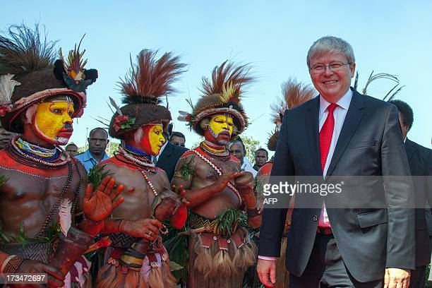 Huli wigmen greet Australian Prime Minister Kevin Rudd as he arrives at the parliament house in Port Moresby on July 15 2013 Australia on July 15...
