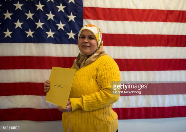 Hulima Rouilli originally from Morocco stands for a picture with her Certificate of Naturalization during a ceremony for new US citizens February 16...