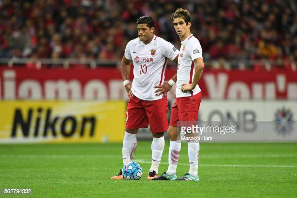 Hulk and Oscar of Shanghai SIPG look on during the AFC Champions League semi final second leg match between Urawa Red Diamonds and Shanghai SIPG at...