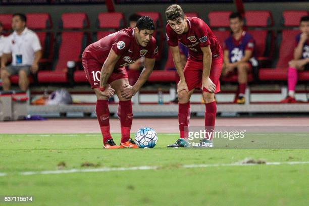 Hulk and Oscar of Shanghai SIPG talk before taking a freekick during the AFC Champions League 2017 Quarterfinals 1st leg between Shanghai SIPG and...