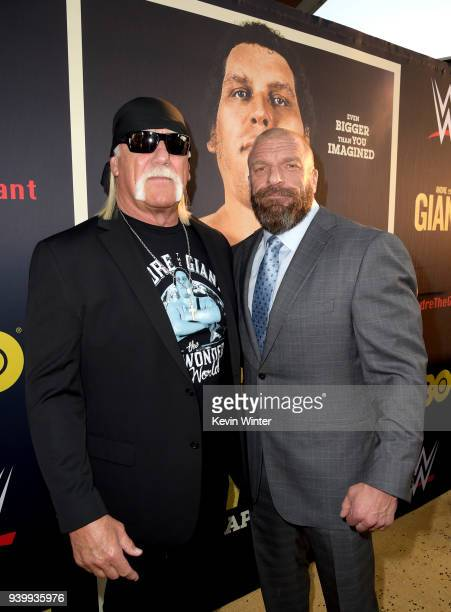 Hulk Hogan and Paul 'Triple H' Levesque arrive at the premiere of HBO's 'Andre The Giant' at the Cinerama Dome on March 29 2018 in Los Angeles...