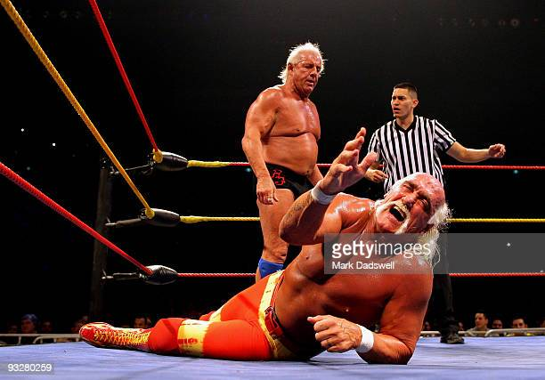 Hulk Hogan grimaces in pain as his opponent Ric Flair stands over him during Hulk Hogan's Hulkamania Tour at Rod Laver Arena on November 21 2009 in...