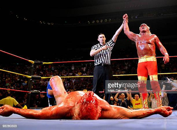 Hulk Hogan is declared the winner as his opponent Ric Flair lays flat on the floor during Hulk Hogan's Hulkamania Tour at Rod Laver Arena on November...