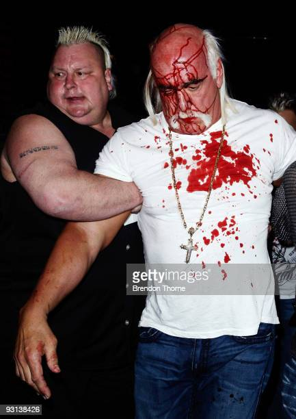 Hulk Hogan is escorted away by Brian Knobbs after an altercation with Ric Flair during a press conference for 'Hulkamania Let The Battle Begin' at...