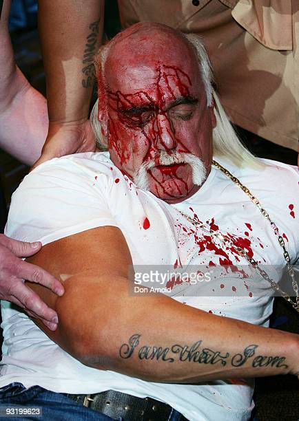 Hulk Hogan is escorted to a backstage area after an altercation involving Ric Flair during a press conference for 'Hulkamania Let The Battle Begin'...
