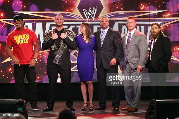 Hulk Hogan, Randy Orton, Stephanie McMahon, Triple H, John Cena, and Daniel Bryan attend the WrestleMania 30 press conference at the Hard Rock Cafe...