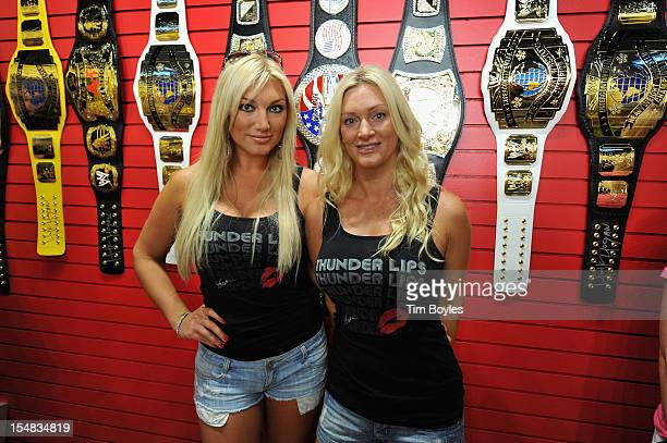 Hulk Hogan's daughter Brooke Hogan and his wife Jennifer McDaniel pose during the grand opening of Hogans Beach Shop on October 27 2012 in Clearwater...