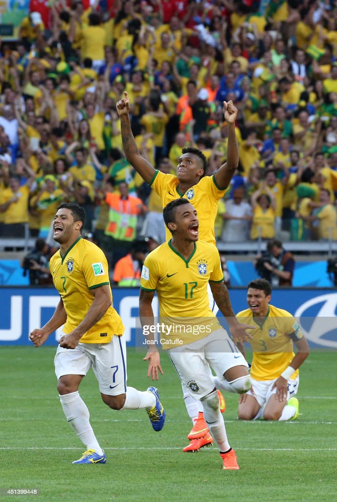 Hulk, Luiz Gustavo, Jo, Thiago Silva of Brazil celebrate the victory after the penalty shootout of the 2014 FIFA World Cup Brazil round of 16 match between Brazil and Chile at Estadio Mineirao on June 28, 2014 in Belo Horizonte, Brazil.