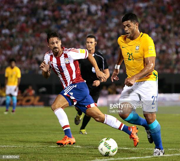 Hulk of Brazil and Jonathan Santana of Paraguay fight for the ball during a match between Paraguay and Brazil as part of FIFA 2018 World Cup...
